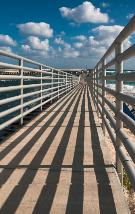 An Image of a pier located in Boynton Beach, where residents call All County Paving for their large asphalt projects